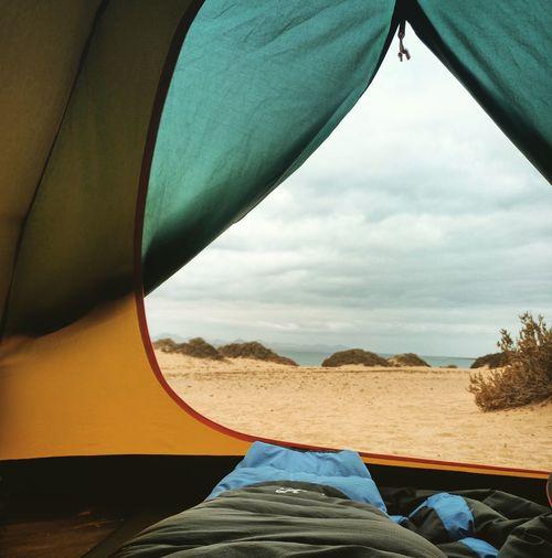 Cloudy Sky Over Sea Seen Through Tent