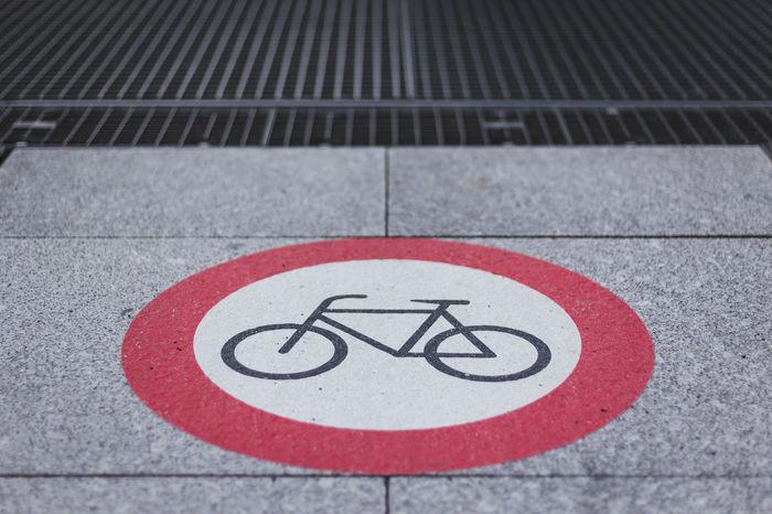 No bicycle sign on the pavement. City City Life Copy Space No Bike Bicycle Bike Communication High Angle View No Bikes No Bikes Allowed No Biking No People Road Road Sign Road Warning Sign Sign Symbol Transportation Warning Sign