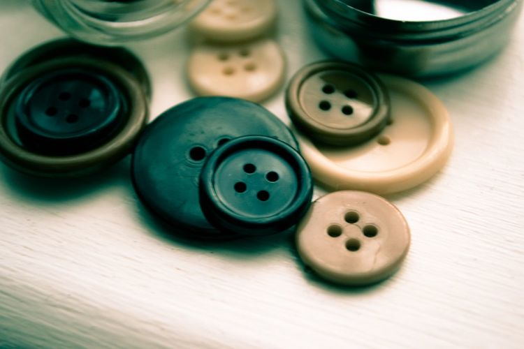 Close-up of buttons on table