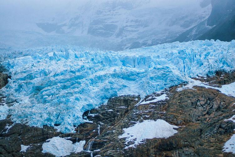 Melting blue glacier ice patagonia