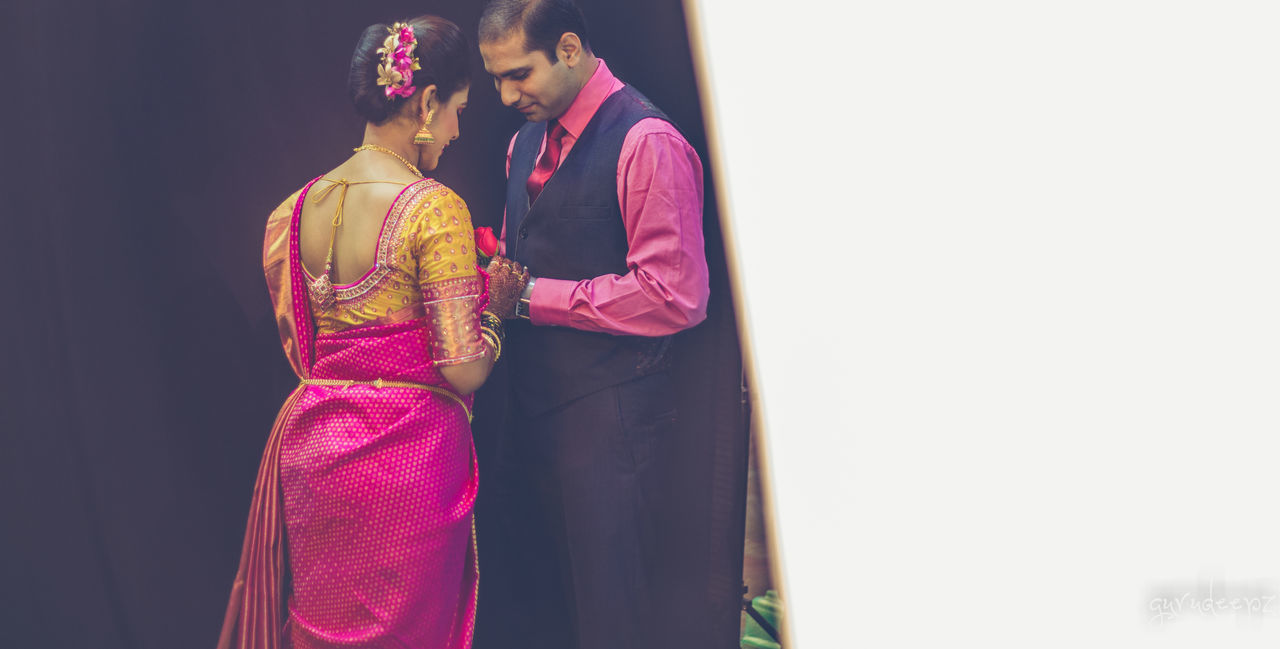 traditional clothing, sari, standing, rear view, cultures, celebration, real people, two people, lifestyles, togetherness, young women, women, young adult, bonding, indoors, groom, bride, day