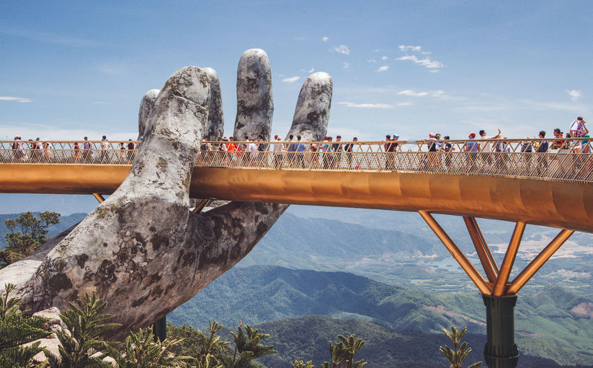 The Golden Bridge at Ba Na Hills in Da Nang Vietnam. The bridge is being held up by 2 giant hands overlooking the mountains and aerial view of Da Nang City. Ba Na Hills Bridges Buddha Footbridge Tourist Trabzon Travel Travel Photography Vietnam Beauty In Nature Bridge Bridge - Man Made Structure Bridge View Cloud - Sky Da Nang Day Golden Bridge Mountain Nature Outdoors Sky Travel Destinations