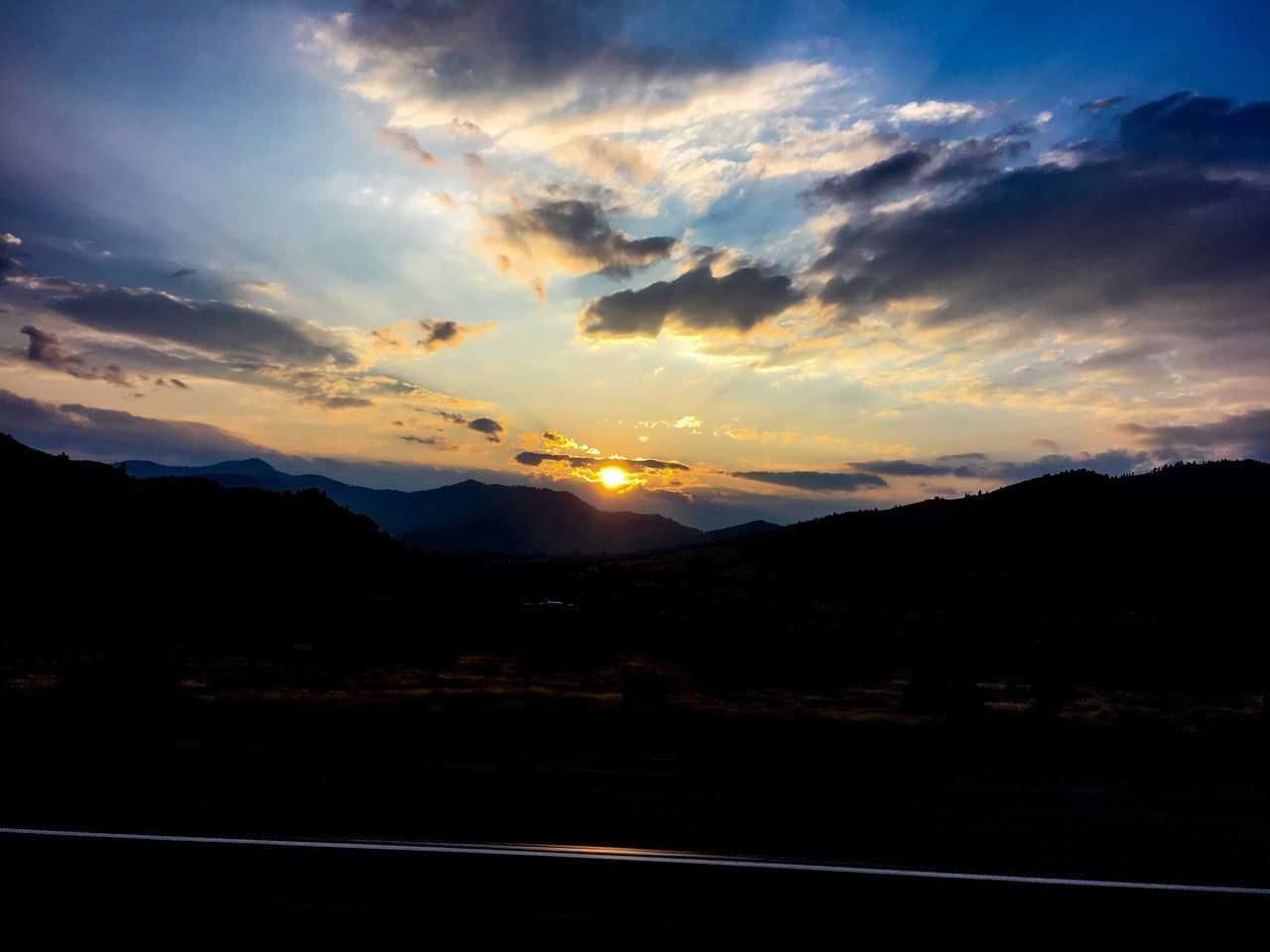 sunset, sky, scenics, nature, tranquility, silhouette, tranquil scene, landscape, beauty in nature, sun, road, no people, cloud - sky, mountain, transportation, outdoors, day