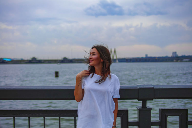 instagram @koolikov One Person Water Standing Young Adult Leisure Activity Railing Front View Lifestyles Sky Young Women Real People Women Smiling Waist Up Nature Hair Hairstyle Beautiful Woman Casual Clothing портрет река забор девушка в белом