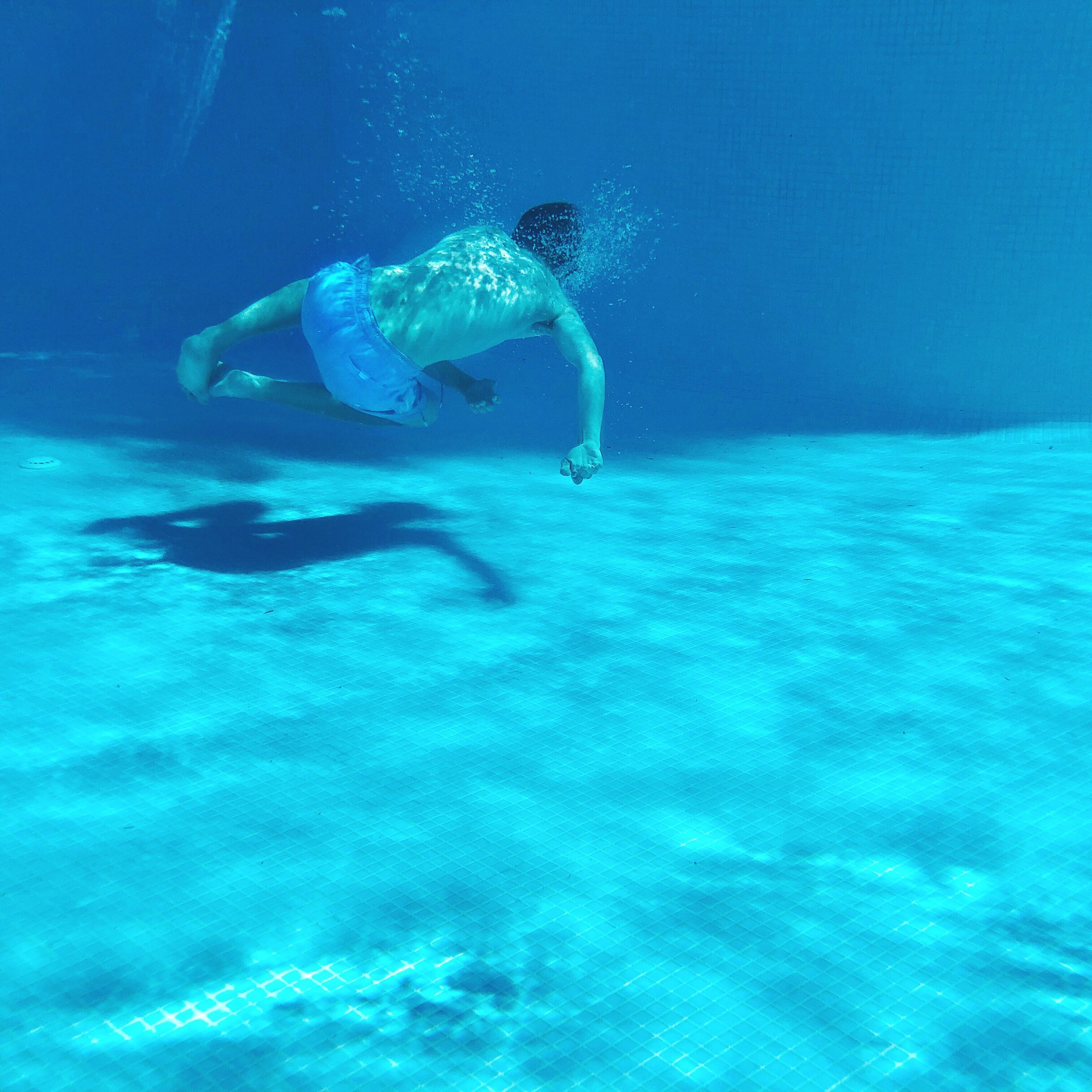 underwater, sea, water, swimming, one person, blue, sport, undersea, adventure, full length, aquatic sport, leisure activity, exploration, nature, vacations, trip, holiday, day, outdoors, snorkeling, turquoise colored