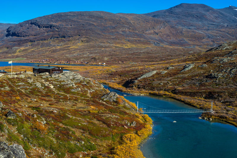September hiking along The King's Trail in northern Sweden 2016 Alesjaure  Autumn Blue Clear Sky Cottage Day Hiking Kungsleden Landscape Laponia Mountain Nature Non-urban Scene Northern Europe Outdoors Remote Rocky Scandinavia September Stream Sweden The Kings Trail Tranquility Water