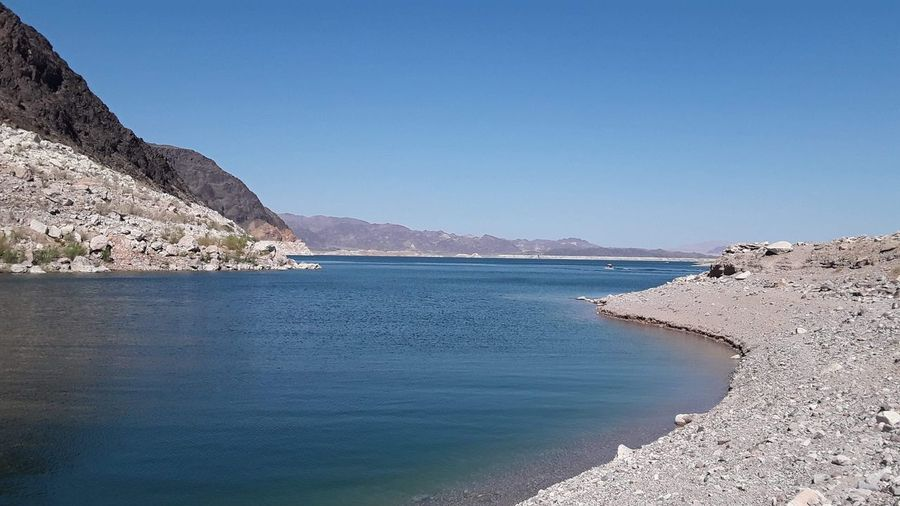 Lake Meade, Nevada EyeEm Selects Water Sea Sky Beauty In Nature Mountain Scenics - Nature Beach Clear Sky Tranquility Tranquil Scene Blue Nature Land No People Day Non-urban Scene Idyllic Outdoors Rock Travel