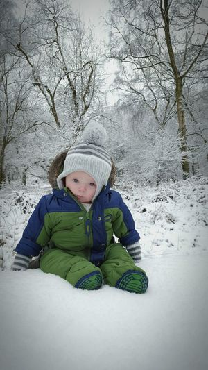 My little fellas first outing in the snow Memories Babiesfirst First Snow Baby Winter Snow Potrait Baby Boy Smartphone Photography