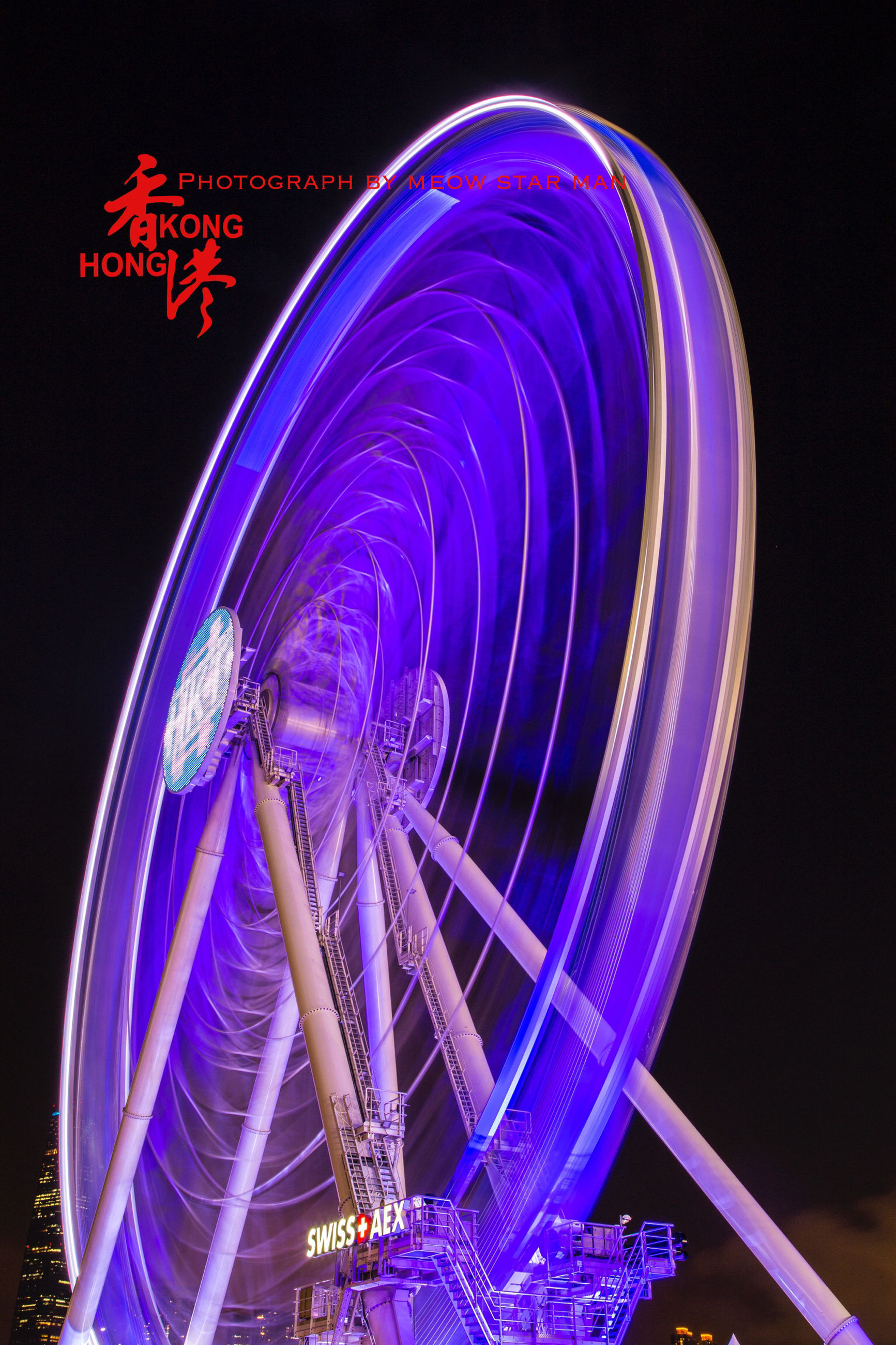 night, illuminated, long exposure, arts culture and entertainment, motion, circle, multi colored, ferris wheel, amusement park, amusement park ride, light trail, speed, spinning, blurred motion, low angle view, glowing, blue, sky, celebration, outdoors