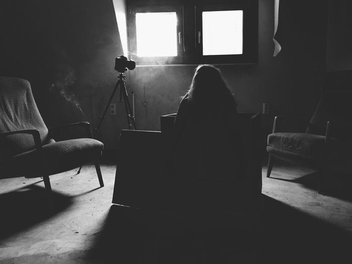 Silhouette Woman Sitting At Home