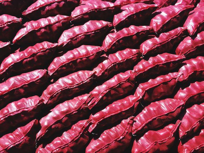 Full frame shot of red sacks