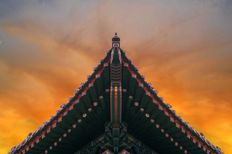 Triangle Shape Roof Against Cloudy Sky At Sunset