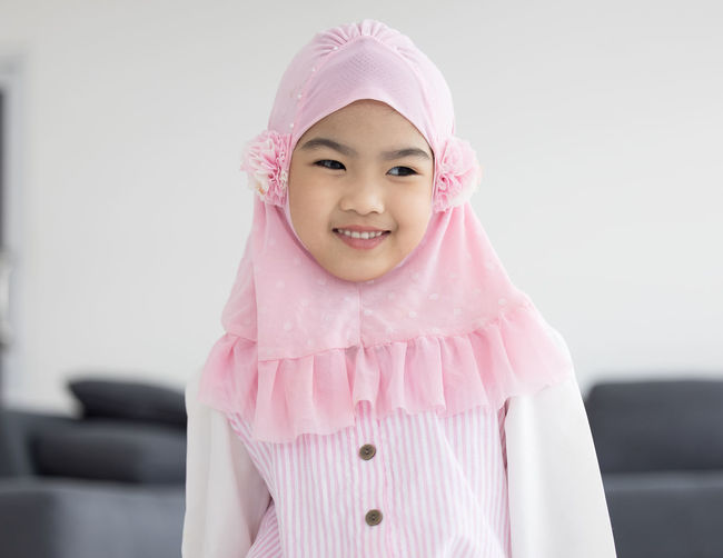 Portrait of happy little muslim girls child with hijab dress smi person