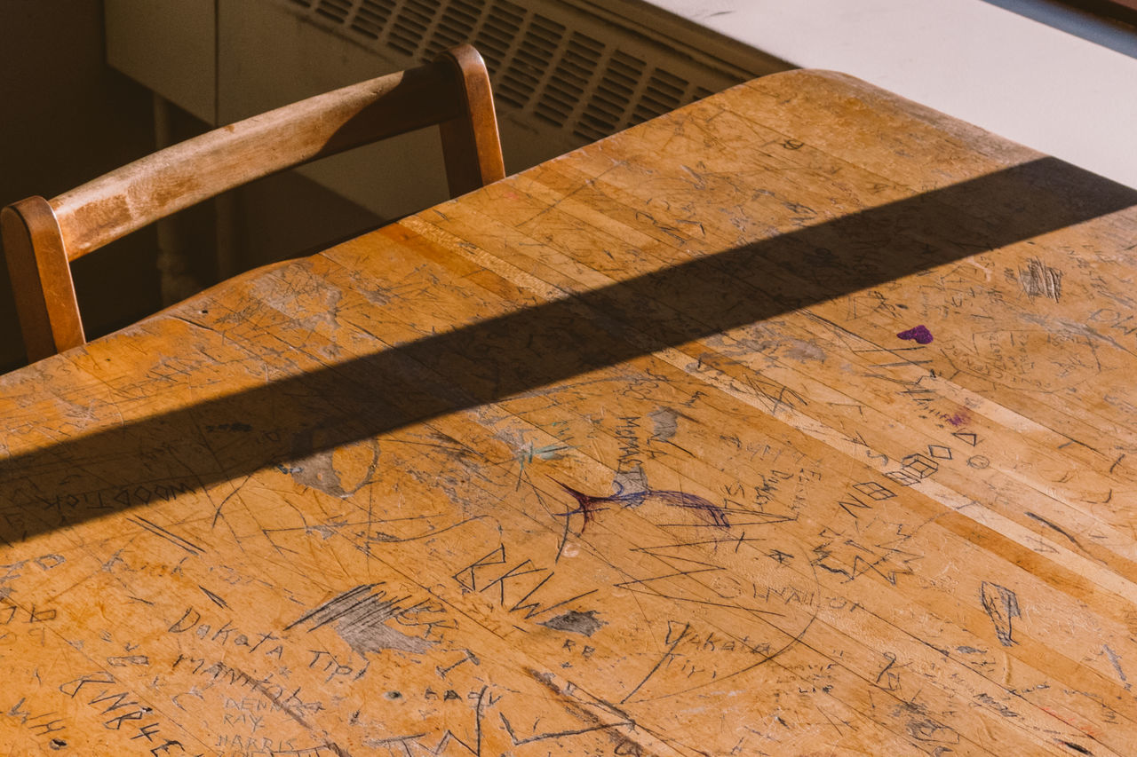 High angle view of old desk and chair in library