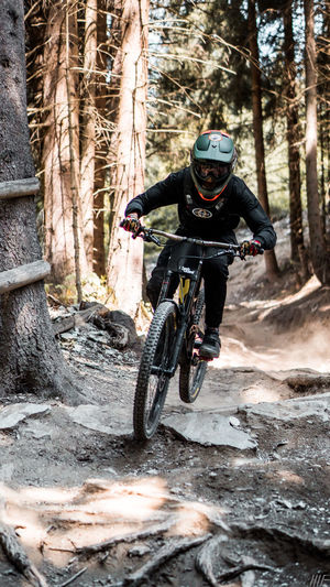 Biker Leogang Sport Transportation Helmet One Person Bicycle Headwear Tree Forest Riding Extreme Sports Ride Motion Leisure Activity Sports Helmet Nature Men Full Length Day Land Skill  Crash Helmet Outdoors WoodLand Freedom