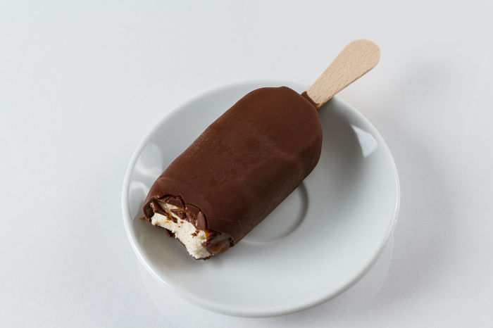 Chocolate covered vanilla and raspberry pospicle Brown Chocolate Covered Close-up Colors Dessert Food Freshness Ice Cream Indulgence No People Plate Popsicle Ready-to-eat Refreshment Serving Size Still Life Studio Shot Sweet Temptation Vanilla White Background