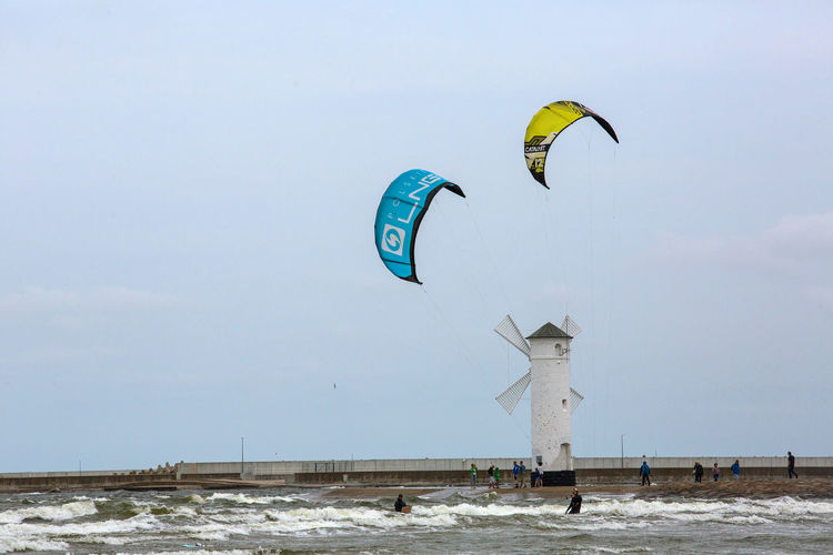 Baltic Baltic Sea Stawa Mlyny Adventure Architecture Built Structure Cold Temperature Copy Space Day Environment Extreme Sports Flying Land Low Angle View Nature No People Parachute Paragliding Sky Sport Winter