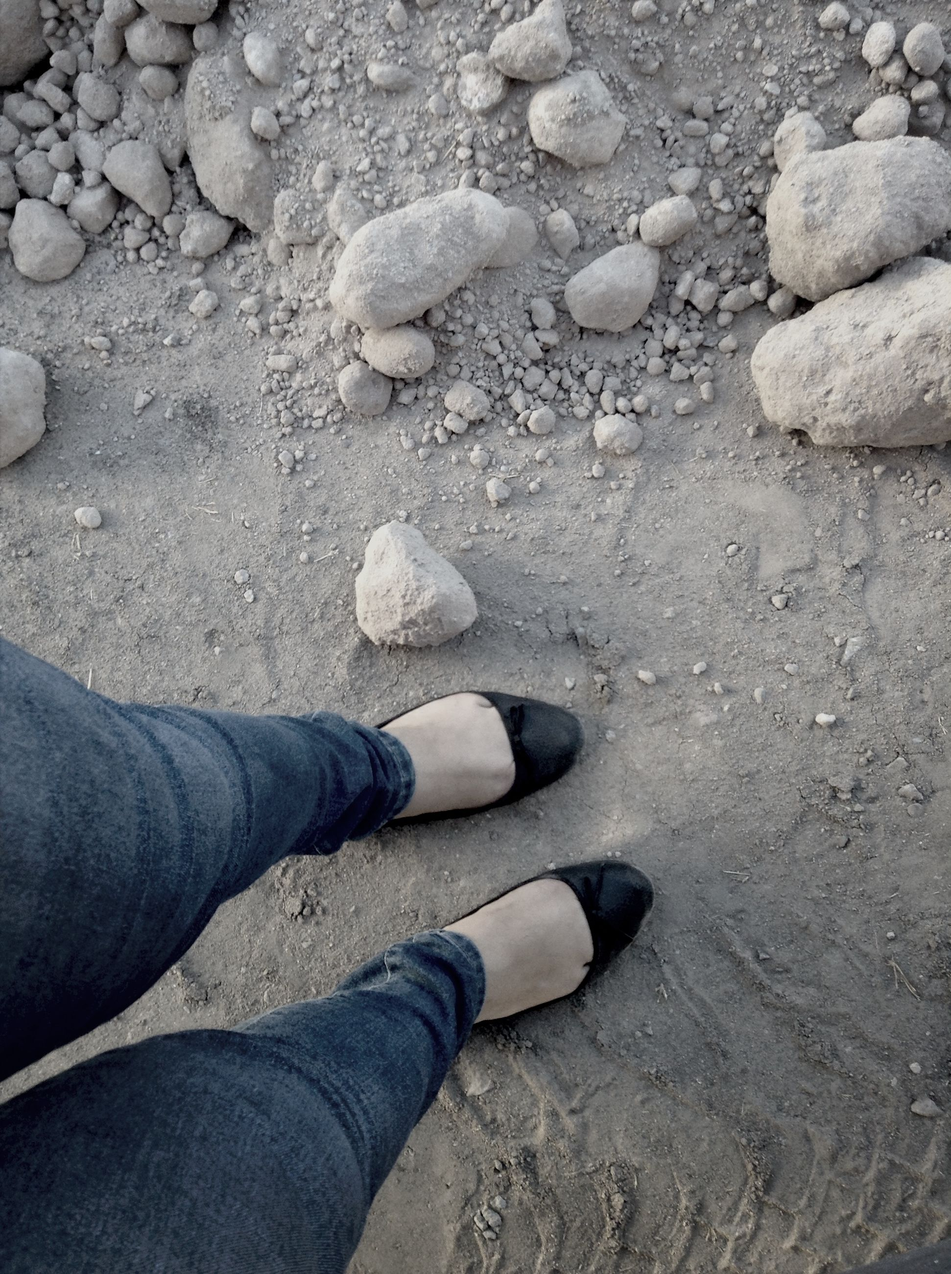 low section, person, shoe, personal perspective, high angle view, human foot, footwear, beach, standing, sand, lifestyles, unrecognizable person, part of, leisure activity, street, jeans, day
