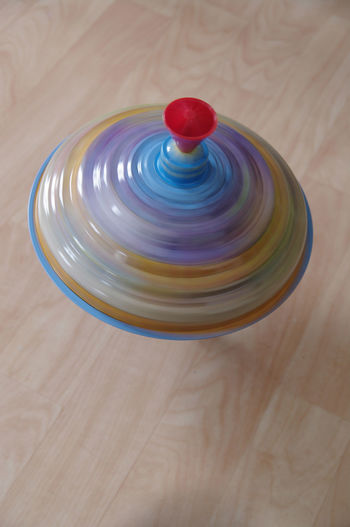 Spinning top Blurred Top Blurred Motion Close-up Day Fast High Angle View Indoors  Multi Colored No People Spinning Spinning Top Table
