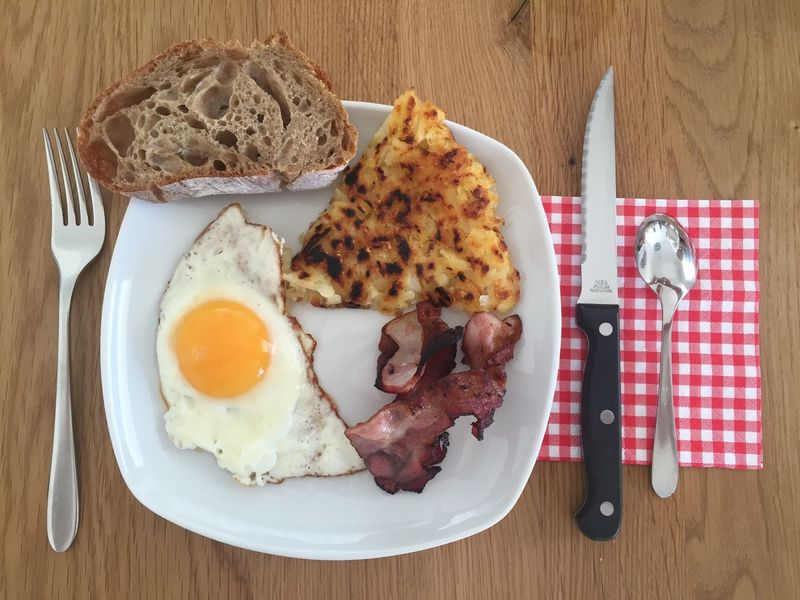 Food Stories Egg Breakfast Food And Drink Plate Bread Fried Egg Swiss Switzerland Homemade At Home Sunday Morning Indoors  Table Fork Bacon Food Directly Above Meat Ready-to-eat No People Freshness Sausage Healthy Eating Day