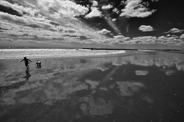On the beach. Monochrome Blackandwhite Beach Sky Water Cloud - Sky Nature People Sea Reflection Beauty In Nature Outdoors Scenics - Nature Beach Sky Water Cloud - Sky Nature People Sea Reflection Beauty In Nature Outdoors Scenics - Nature