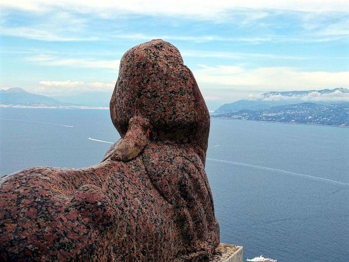 Statue overlooking bay