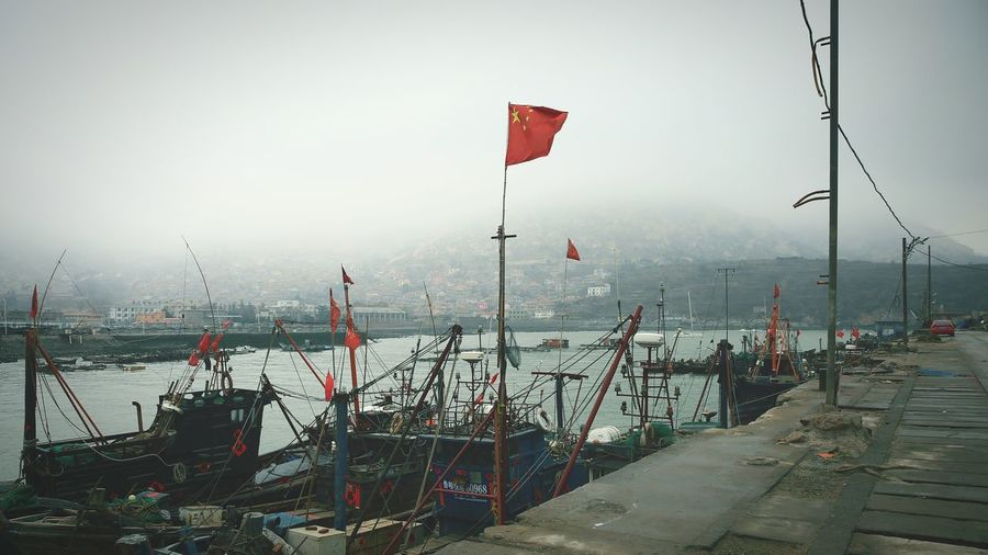 Chinese flag on pole at harbor