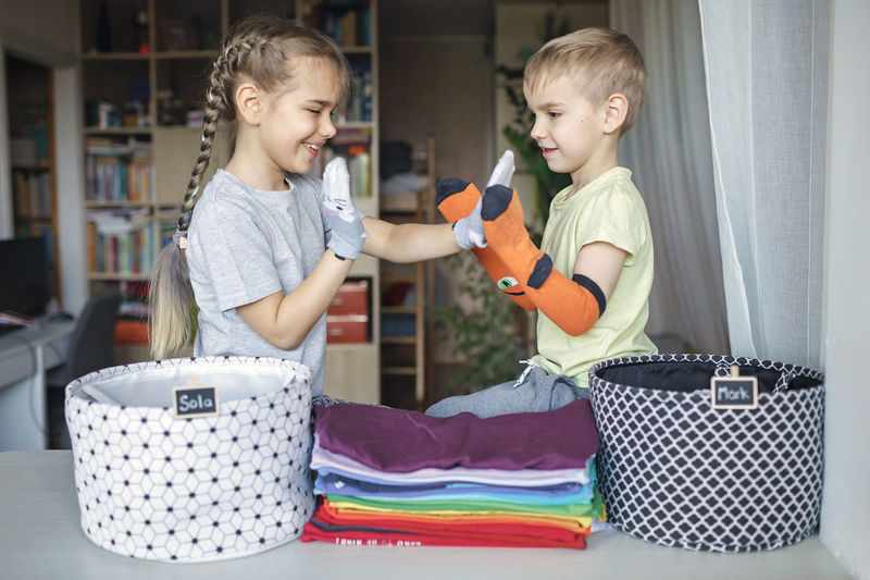 Siblings playing with sock at home