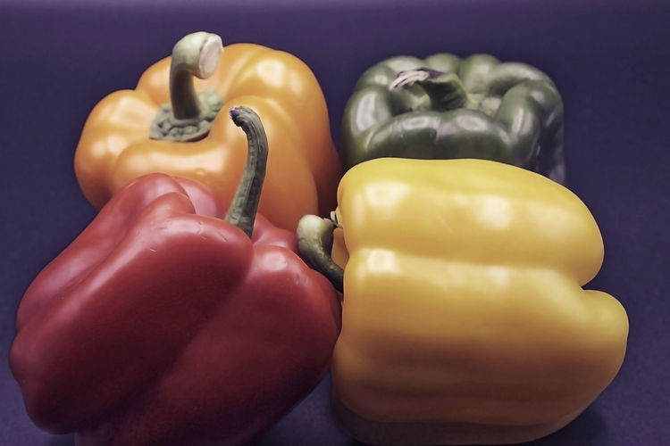 Close-up of yellow bell pepper against colored background
