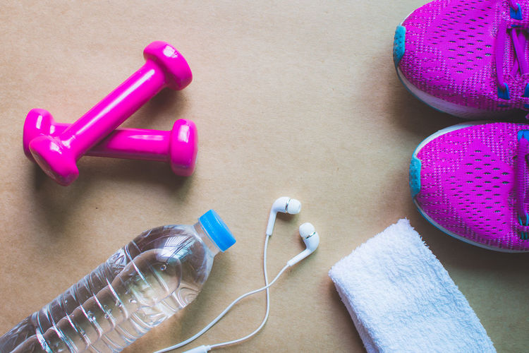 Fitness Equipment Dumbbell Gym Indoors  High Angle View Still Life Close-up Table No People Healthcare And Medicine Exercise Equipment Weights Healthy Lifestyle Needle Weight Pink Color Medicine Exercising Blue Sports Training Listening Weight Training