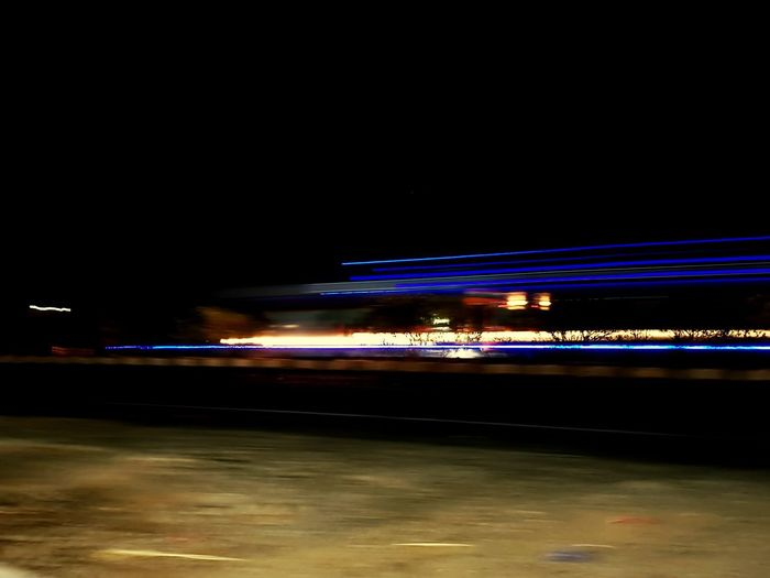 Night Illuminated Light Trail Speed Long Exposure Outdoors Motion Transportation No People Water Sky Nature