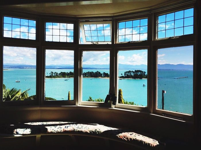 The View - EyeEmNewHere Relaxing Happy Fine Art Photography Clouds And Sky Sea And Sky New Zealand Gratitude Island View Stunning View Living Room Window Window View Happiness Architecture Architectural Detail Bay Window Bay Atmospheric Mood Atmosphere