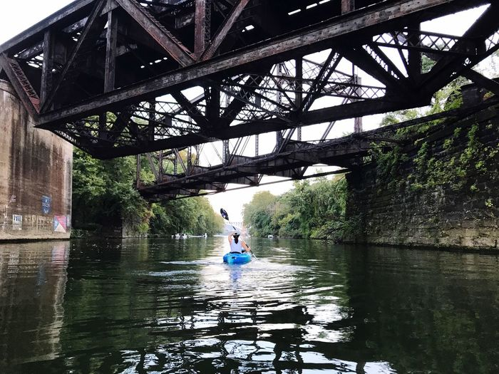 Real People One Person Lifestyles Water Bridge - Man Made Structure Full Length Day Built Structure Leisure Activity Men Architecture Outdoors Nature Women Adult Sky People Adults Only Only Men Kayak