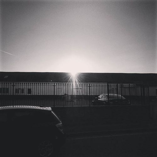 Sun setting, a little earlier these days 17:51pm.. Sunset Sun Afternoon Sunsraze Raze Bw BlackandWhite Stevenage Hertfordshire Cars Building Fence ican Capture Snapshot Sony Xperia