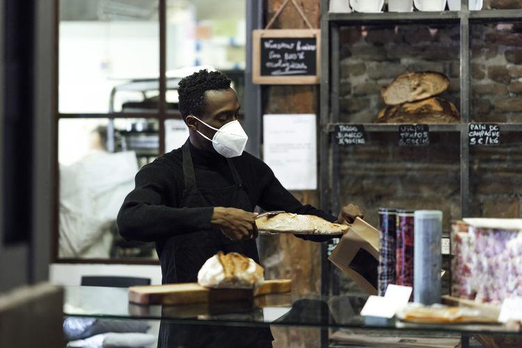 Man having food at store