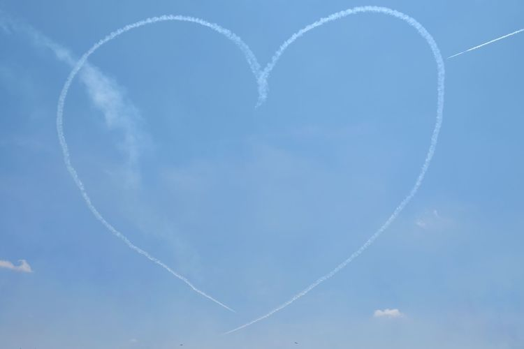 Heart Vapor Trail Cloud - Sky Sky Heart Shape Positive Emotion No People Flying Love Nature Emotion Blue Airplane Day Airshow Outdoors Creativity Air Vehicle