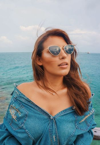 EyeEm Selects Sunglasses Glasses One Person Fashion Young Adult Young Women Water Lifestyles Leisure Activity Real People Sea Front View Sky Day Beauty Hair Beautiful Woman Women Beauty In Nature