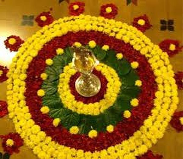 It is beautiful flower decoration done by Kerala women to celebrate the ONAM festival. Kerala is the southern state of Flower