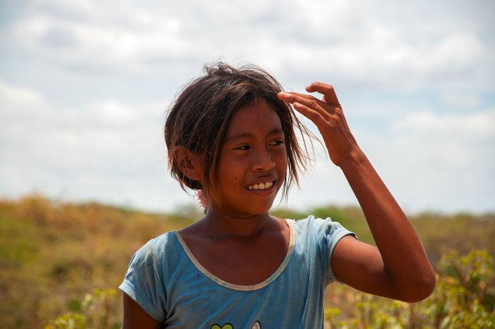 LA GUAJIRA, COLOMBIA - AUGUST 5: A Wayuu Indian child in the desert in La Guajira, Colombia on August 5, 2012 America Arid Child Children Colombia Colorful Culture Desert Desolate Ethnic Face Girl Guajira Guajira, Colombia Hot Indian Indigenous  Landscape Native Nature Person Portrait Wayuu Wayuuculture Young