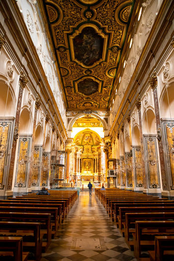 Italy Amalfi  Amalfi Coast Architecture Building Religion Built Structure Spirituality Place Of Worship Belief Seat Pew The Way Forward Direction Rear View Travel Destinations One Person Sitting Incidental People Indoors  Aisle Ceiling Ornate