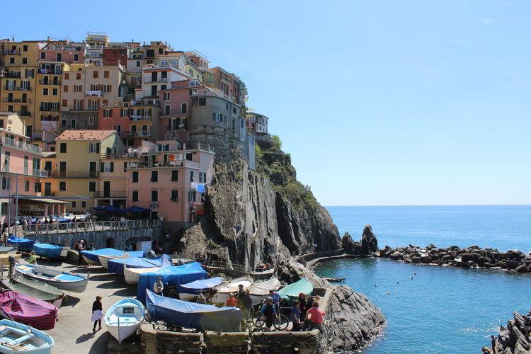 Town Against Calm Blue Sea