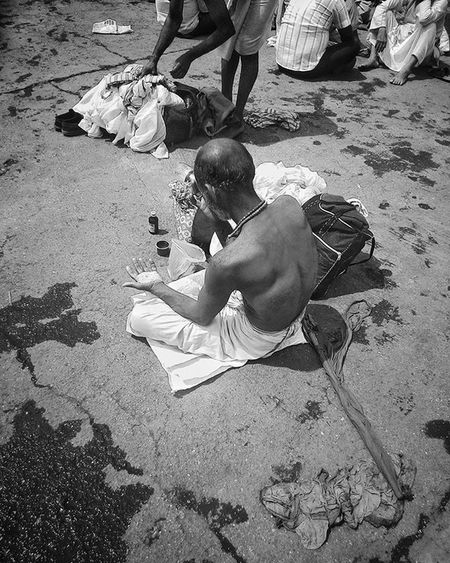 "A sadho putting ""tilaka"" on his forehead after taking a bath in the holy Godavari river during Kumbha Mela, Nashik 2015. It is believed that taking a dip in the Godavari river during this time washes away all your sins. I am wondering why a sadho who has given up everything for a spiritual life needs to take a dip. Streetphotography Travellerslife Travellers Black White Street Streetphotography Blackandwhite Blackandwhitephotography Photooftheday Photographyfortravellers Sacredheart Faith Maharashtra_ig Maharashtra Mahakumbh Mahakumbhmela Kumbhmela Kumbh Nashik Nashikdiaries Nashikgram Godavari GodIsGood God indian indianphotosociety better betterphotography godavari walkoffaith2015 walkoffaith"