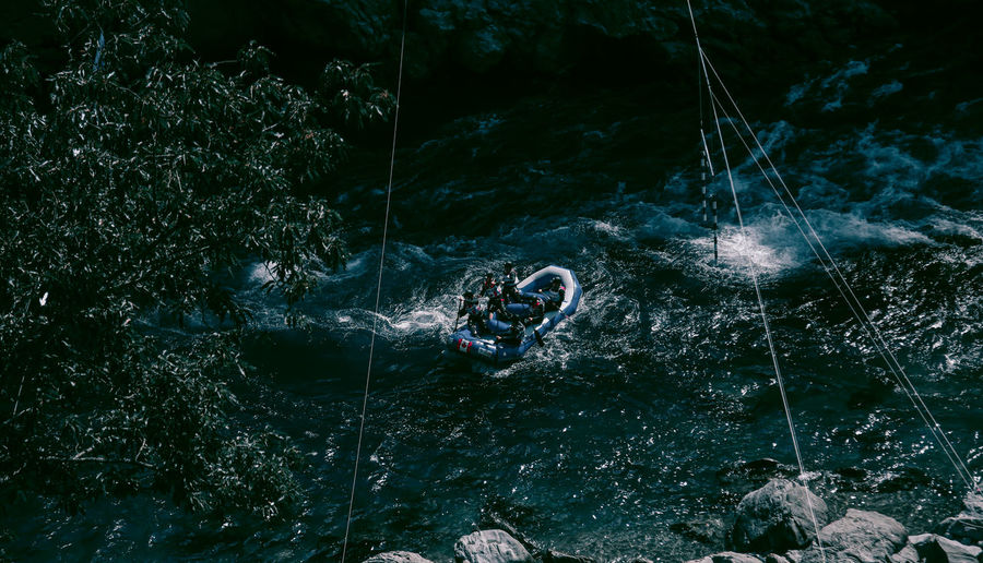 High angle view of men rafting on river