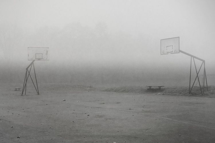 Scenic view of fog on field against sky