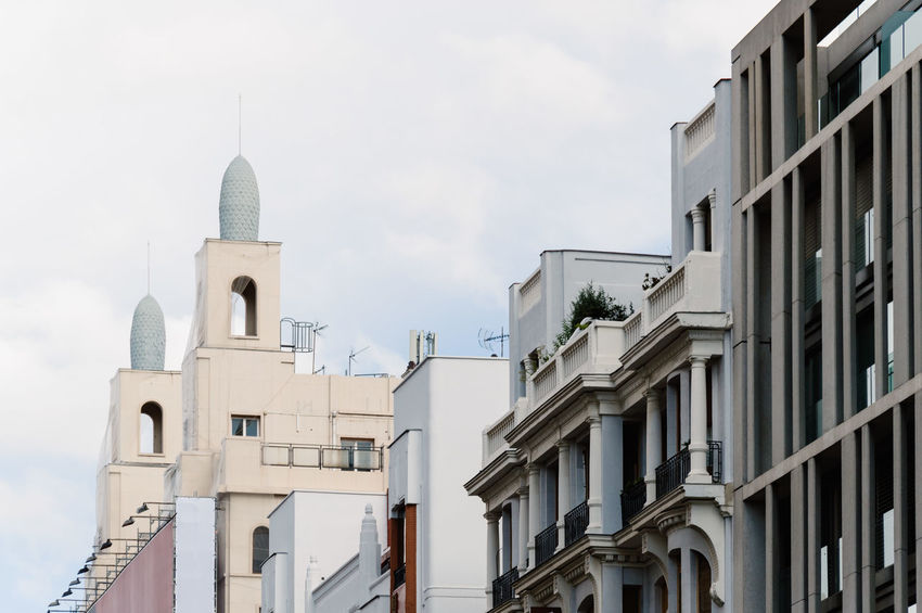 Low angle view of buildings in Gran Via Street in Madrid Architecture Architecture Building Building Exterior Built Structure Cityscape Cityscapes Day Gran Via Look Up Low Angle View Madrid No People Outdoors Religion Sky Street Urban Urban Skyline Whitewashed