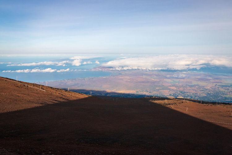 Conical shadow of haleakala volcano at sunrise on the hawaiian island of maui, usa against sky