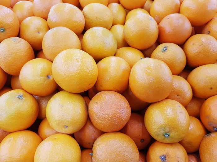 Fresh orange fruits sale at supermarket Fruit Full Frame Healthy Eating Freshness Food And Drink Large Group Of Objects Market Backgrounds Citrus Fruit Food No People Day Close-up Nature Choice Store Business Market Orange Fruits Vitamin Juice Nutrition Taste Flavor
