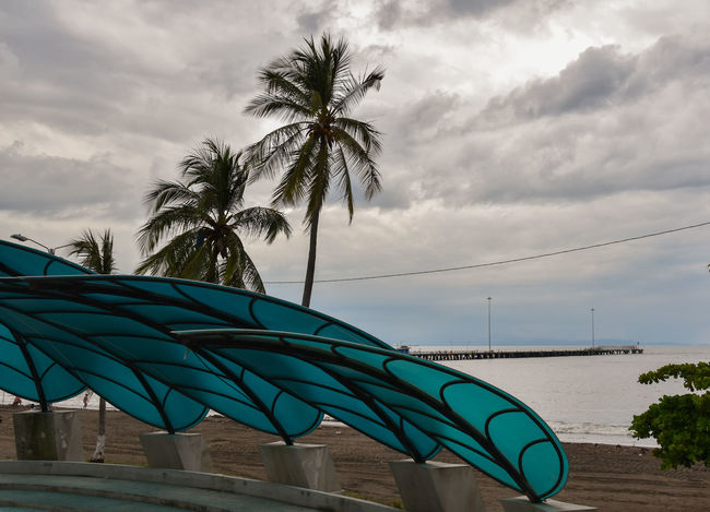 "At the ""paseo de los turistas"" in Puntarenas, Costa Rica Costa Rica Costa Rica 🇨🇷 EyeEm Best Shots Nikon Puntarenas Beach Cloud - Sky Day Muelle No People Openairtheatre Outdoors Palm Tree Port Puerto Sea Sky Water"