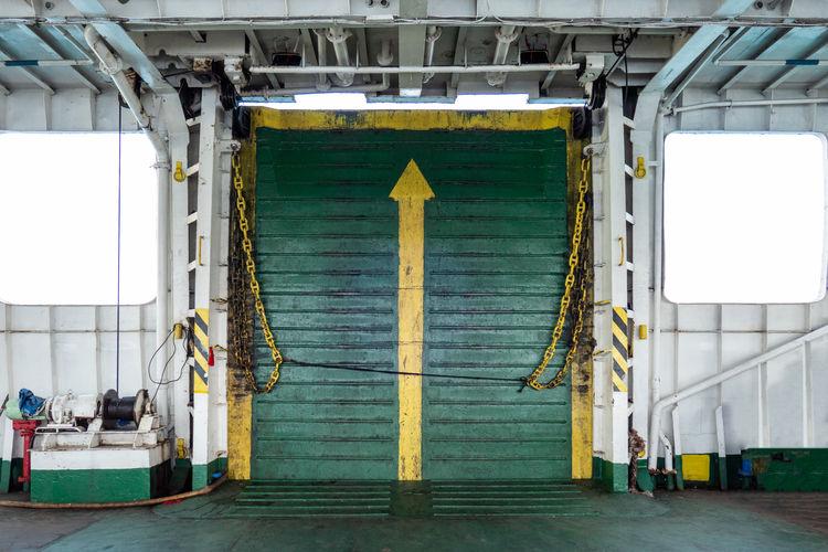 Empty corridor against windows in ship