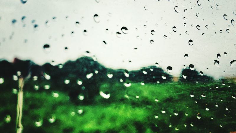 Transparent Wet Drop Window Water Rain Glass - Material Transparent Indoors  Focus On Foreground Sky Day No People City Life Full Frame Freshness What You See In Rain Rain View Through My Camera Lens Rain View From Helmet